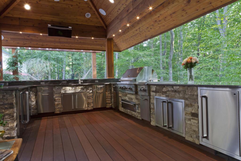 outdoor kitchen under pavilion in Clifton landscape